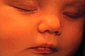 Babies, Baby, Calm, Calmness, Catnap, Child, Children, Close up, Close-up, Closed eyes, Closeup, Color, Colour, Contemporary, Doze, Face, Faces, Forty winks, Headshot, Headshots, Horizontal, Human, Infant, Infants, Innocence, Innocent, Kid, Kip, Little o