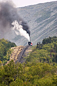 Coal fired steam engine powering the Cog Railway to the summit (elevation 6,288 ft) of Mt. Washington, White Mountains of New Hampshire, USA