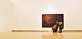 Painting by Fred Tomaselli being viewed in gallery