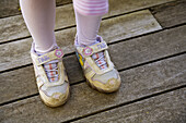 Shoes on the wrong feet of 6 year old girl