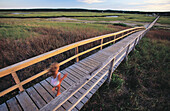 Littler girl on Sandwich Boardwalk. Cape Cod. MA. USA
