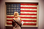 Flag (c. 1954), by Jasper Johns. Visitor at Museum of Modern Art. New York City. USA
