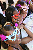 Black students with party glasses at Non-Violence Project USA End of Year Awards Ceremony. Hialeah Gardens, Florida. USA