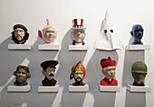 Convention Center, Arte Americas, Latin American Art Fair, male human heads, outfits. Miami Beach. Florida. USA.