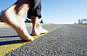 Activity, Adult, Adults, Advance, Advancing, Anonymous, Asphalt, Barefeet, Barefoot, Color, Colour, Contemporary, Daytime, Detail, Details, Exterior, Feet, Foot, Future, Going forward, Ground, Grounds, Horizon, Horizons, Horizontal, Human, Idea, Ideas, M