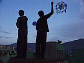 Kids fly kites on Day of the Dead in San Lucas Toliman, Guatemala, near Lake Atitlan