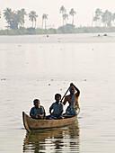 Boat travelling on Vembanad Lake near Alappuzha (Allepey). India