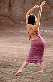 Activity, Adult, Adults, Alone, Back, Back view, Barefeet, Barefoot, Beauty, Beauty Care, Body, Brown, Brunette, Brunettes, Carnal, Carnality, Color, Colour, Contemporary, Dance, Dancing, Dark-haired, Daytime, Dress, Dresses, Earth, Elegance, Elegant, Ex