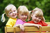 Sisters (triplets) in wagon