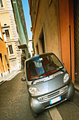 Smart car transportation in the streets of Rome. Italy