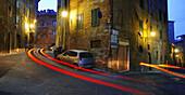 Car light trails on street at dusk. Siena. Tuscany, Italy