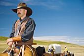Cowboys and chuck wagon. Porcupine Hills. Southern Alberta. Canada.