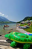 Beach and sunbathing area at lake Walchsee, Tyrol, Austria