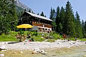 Lodge Reintalangerhuette and beach at stream Partnach with sunshade, Wetterstein range, Garmisch-Partenkirchen, Upper Bavaria, Bavaria, Germany