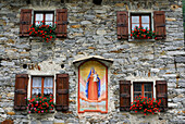 Fascade with picture of the Virgin Mary, Sonogno, Valle Verzasca, Canton of Ticino, Switzerland