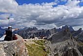 hikers at summit of Nuvolau, in background Croda da Lago, Monte Formin, Ra Gusela and Pelmo behind, Alta Via delle Dolomiti No. 1, Dolomites, Cortina, Venezia, Italy