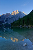 lake Pragser Wildsee and reflektion of Seekofel in morning light, Alta Via delle Dolomiti No. 1, Parco Naturale Fanes-Sennes, Dolomites, South Tyrol, Alta Badia, Italy