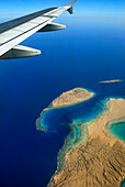 Aircraft wing above Red Sea, shore with reef, Hurghada, Egypt, Africa