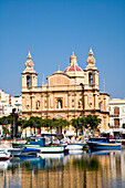 Fishing boats at harbour in front of the St. Joseph Church, Msida, Malta, Europe