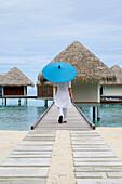 Woman, Spa therapist with parasol, Spa Pavilions, Four Seasons Resort Landaa Giraavaru, Maldives