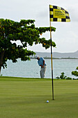 Man playing golf, One & Only Le Touessrok Golf course, Bernhard Langer Design, Mauritius