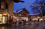 Christmassy decorated houses in the evening, Garmisch, Garmisch-Partenkirchen, Upper Bavaria, Germany