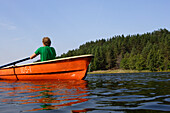 Man rowing a boat on Lake Lusis in Paluse, Aukstaitija National Park, Lithuania