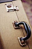 Baggage, Close up, Close-up, Color, Colour, Concept, Concepts, Detail, Details, Handle, Handles, Indoor, Indoors, Inside, Interior, Luggage, Metal, Metallic, Move, Moves, Moving, Object, Objects, Old-fashioned, Suitcase, Suitcases, Thing, Things, Travel,