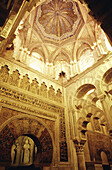 Mihrab (inscriptions around 965 AD), Quibla (sacred wall), cupule (mosaics, 965 AD) and macsura arcs. Mezquita - Mosque of Cordoba. One of the biggest mosques in the world with 23.400 square meters, 500 columns and superimposed arches...