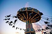 People on carousel. Miami country fair. Florida. USA