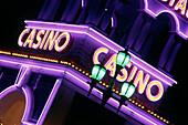 Casino s purple neon lights at night. Oranjestad. Aruba. Netherlands Antilles