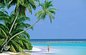 Woman on tropical beach. Maldives Islands