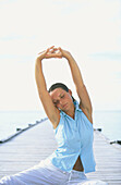 Woman performing yoga in White Sands Resort and Spa. Ari Atoll, Maldives