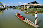 Monk on boat for alms. Inle Lake. Shan State. Myanmar.