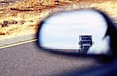 Truck in rearview mirror