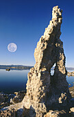 Full moon over tufa formations on the south shore of Mono Lake. Mono Basin National Forest Scenic Area. California. USA