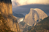 Late afternoon light on Half Dome and El Capitan under storm clouds, Yosemite Valley, Yosemite National Park, California
