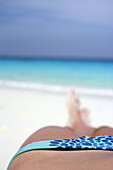 Adult, Adults, Beach, Beaches, Bikini, Bikinis, Blue, Chill out, Chilling out, Coast, Coastal, Color, Colour, Contemporary, Daytime, Exterior, Female, Holiday, Holidays, Human, Leg, Legs, Leisure, Lying down, One, One person, Outdoor, Outdoors, Outside,