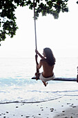 Adult, Adults, Alone, Beach, Beaches, Calm, Calmness, Chill out, Chilling out, Color, Colour, Contemporary, Daytime, Exterior, Female, Holiday, Holidays, Horizon, Horizons, Human, Leisure, Mood, One, One person, Outdoor, Outdoors, Outside, Peaceful, Peac