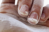 Adult, Adults, Close up, Close-up, Closeup, Color, Colour, Concept, Concepts, Dirty hand, Dirty hands, Dust, Finger, Fingernail, Fingernails, Fingers, Hand, Hands, Human, Nail, Nails, One, One item, People, Person, Persons, White, G85-494685, agefotostoc