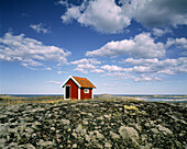 Small hut at the coastline of the Baltic Sea. Tjust Archipelago, Sweden, Scandinavia, Europe.