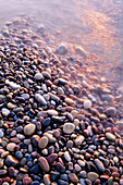 Colorfull rubble stones at waters edge, by the Baltic Sea. East coast of Skåne, Sweden.