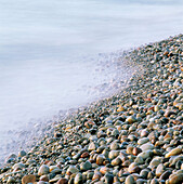 Rubble stones at waters edge. Kivik, by the Baltic Sea, Skåne, Sweden.