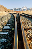 Railroad tracks with mountains in background