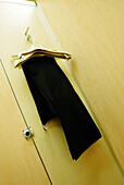 Changing room, Changing rooms, Close up, Close-up, Closed, Closeup, Color, Colour, Concept, Concepts, Door, Doors, Fitting room, Fitting rooms, Garment, Hang, Hanger, Hangers, Hanging, Indoor, Indoors, Inside, Interior, Pant, Pants, Trouser, Trousers, Ve