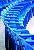 Arrangement, Audience, Blue, Chair, Chairs, Color, Colour, Concept, Concepts, Detail, Details, Empty, Indoor, Indoors, Inside, Interior, Line, Lined up, Lined-up, Lines, Many, Order, Plastic, Ready, Row, Rows, Vertical, G96-216007, agefotostock