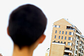 Adult, Adults, Apartment, Apartments, Back view, Block, Blocks, Building, Buildings, Cities, City, Close up, Close-up, Closeup, Color, Colour, Contemporary, Daytime, Exterior, Flat, Flats, Head, Heads, Horizontal, Human, Look, Looking, One, One person, O