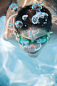 Action, Activity, Air, Amusement, Bubble, Bubbles, Caucasian, Caucasians, Childhood, Children, Color, Colour, Contemporary, Dive, Diving, Face, Faces, Fun, Goggles, Headshot, Headshots, Holiday, Holidays, Human, Infantile, Leisure, One, One person, Peopl