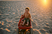 Amusement, Beach, Beaches, Boy, Boys, Caucasian, Caucasians, Child, Childhood, Children, Children only, Color, Colour, Contemporary, Dark-haired, Daytime, Exterior, Exuberance, Exuberant, Facial expression, Facial expressions, Facing camera, Full-body, F