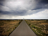Cloudy, Coast, Coastal, Color, Colour, Daytime, Deserted, Exterior, Far away, Guidance, Horizon, Horizons, Landscape, Landscapes, Lighthouse, Lighthouses, Nature, Navigation, Outdoor, Outdoors, Outside, Overcast, Perspective, Remote, Road, Roads, Scenic,